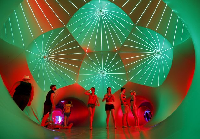 Revellers relax inside a 3-D Luminarium inflatable installation by British designer Alan Parkinson during Sziget music festival on an island in the Danube River in  Budapest, Hungary August 12, 2015. (Photo by Laszlo Balogh/Reuters)