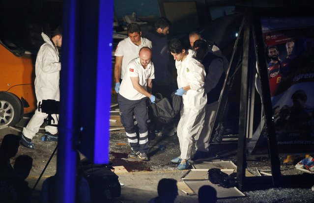 Turkish rescue services carry a victim from the scene of a blast outside Istanbul's Ataturk airport, early Wednesday, June 29, 2016. Two explosions have rocked Istanbul's Ataturk airport, killing several people and wounding others, Turkey's justice minister and another official said Tuesday. A Turkish official says two attackers have blown themselves up at the airport after police fired at them. (Photo by Emrah Gurel/AP Photo)