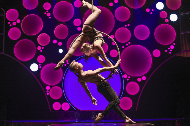 Spencer Craig (bottom) and Caitlin Thomson Moylan (top) of the Blanc de Blanc Encore perform during a media preview of the Garden of Unearthly Delights festival precinct at Rundle Park in Adelaide, Australia, 13 February 2020. (Photo by Roy Vandervegt/EPA/EFE)
