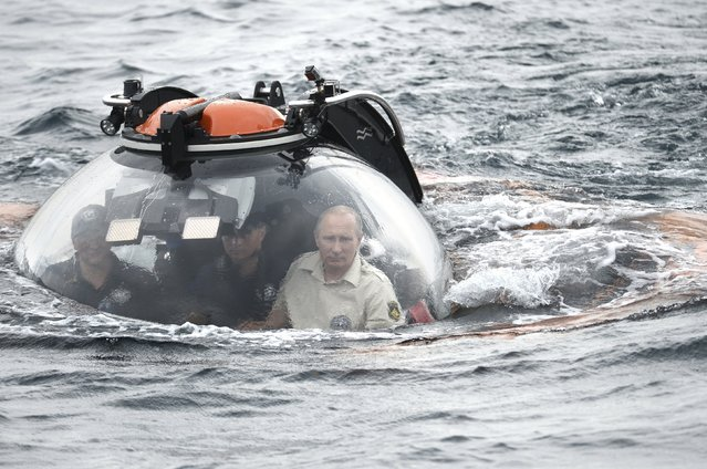 Russian President Vladimir Putin (R) is seen inside a research bathyscaphe while submerging into the waters of the Black Sea as he takes part in an expedition near Sevastopol, Crimea, August 18, 2015. (Photo by Alexei Nikolsky/Reuters/RIA Novosti/Kremlin)