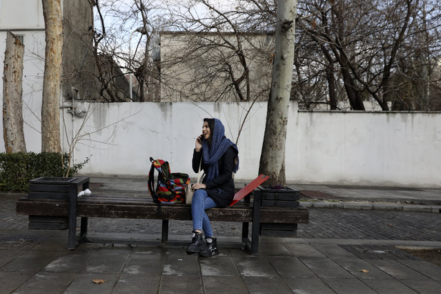 A woman talks on her cell phone in northern Tehran, Iran, Thursday, January 9, 2020. (Photo by Vahid Salemi/AP Photo)
