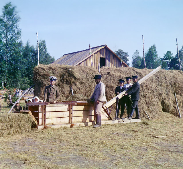Photos by Sergey Prokudin-Gorsky. Baling machine for hay. Russia, Olonets province, Petrozavodsk uyezd (district), Kivach station, 1916