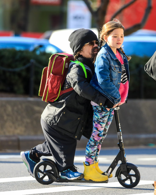 "Peter Dinklage spotted on a scooter ride with his daughter in New York City on March 2, 2020. The 50 year old ""Game of Thrones"" actor wore a black beanie, Barbour jacket, dark trousers and sneakers. (Photo by The Image Direct)"