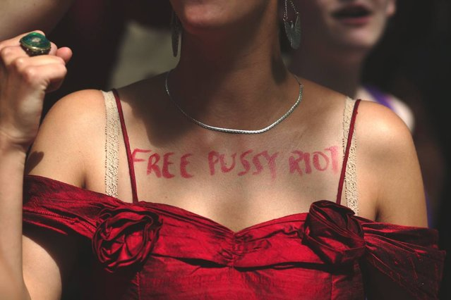 A woman wears on her chest the text 'free p*ssy riot' as a demonstration by supporters of the jailed feminist punk band 'p*ssy Riot' takes place outside the Russian Embassy on August 17, 2012 in London, England. The three women who staged an anti-Kremlin protest in a church in February, were found guilty today of hooliganism motivated by religious hatred, and could face a three-year jail sentence. Supporters are gathering in several cities around the world today as a mark of solidarity. (Photo by Dan Kitwood)
