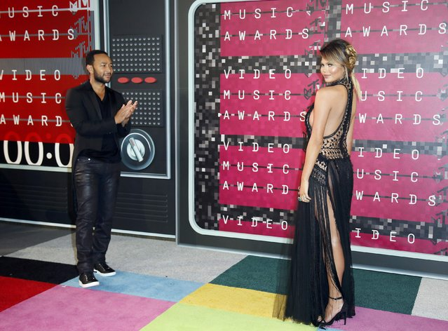 Musician John Legend and model Chrissy Teigen arrive at the 2015 MTV Video Music Awards in Los Angeles, California, August 30, 2015. (Photo by Danny Moloshok/Reuters)