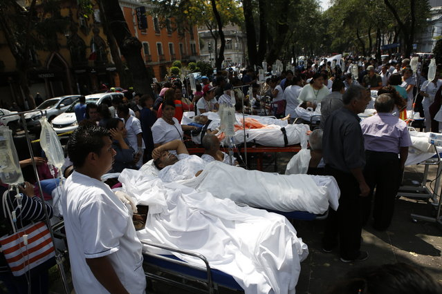 Patients lie on their hospital beds after being evacuated following an earthquake in Mexico City, Tuesday, September 19, 2017. (Photo by Rebecca Blackwell/AP Photo)