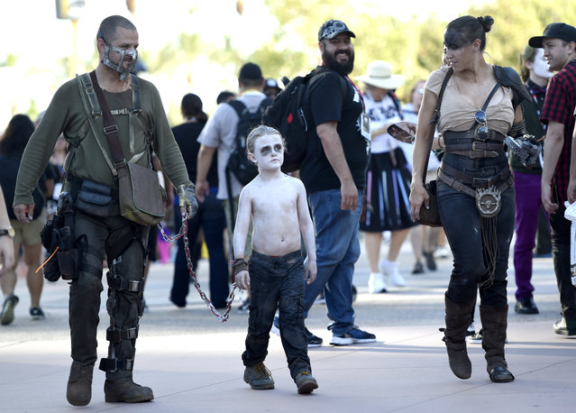 David LeBeau, dressed as Mad Max, from left, Liam LeBeau, dressed as Nux, and Riana LeBeau, dressed as Furiosa, attend day 2 of Comic-Con International on Friday, July 22, 2016, in San Diego. (Photo by Chris Pizzello/Invision/AP Photo)