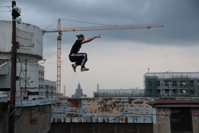 Urban explorer Vad Him of Rudex team jumps whilst on a rooftop in Moscow, Russia, August 14, 2017. (Photo by Maxim Shemetov/Reuters)