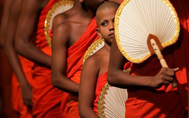 Buddhist monks walk during the annual Nawam Maha Perahera of Gangaramaya Buddhist temple in Colombo, Sri Lanka on Faberuary 7, 2020. (Photo by Dinuka Liyanawatte/Reuters)
