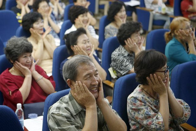 Grandparents take part in a child care class for them in Seoul, South Korea, September 1, 2015. It is not unusual for South Koreans to pay their parents to take care of their children. But the number doing so is on the rise and the arrangement has become more professional-like as parents increasingly pay the equivalent of full babysitting rates. (Photo by Kim Hong-Ji/Reuters)