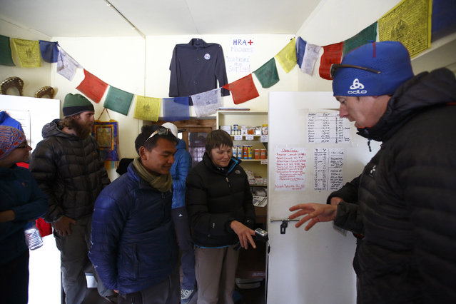 Trekkers have their oxygen level checked at the Himalayan Rescue Association Nepal post in Pheriche, approximately 14107 feet above sea level, in Solukhumbu District May 3, 2014. (Photo by Navesh Chitrakar/Reuters)