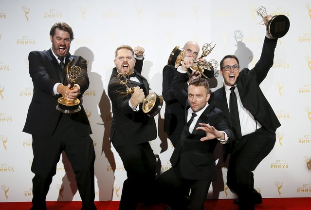 "Chris Hardwick (2nd-R front) poses along with other producers with their outstanding interactive media (juried) awards for ""@Midnight with Chris Hardwick"" backstage at the 2015 Creative Arts Emmy Awards in Los Angeles, California September 12, 2015. (Photo by Danny Moloshok/Reuters)"