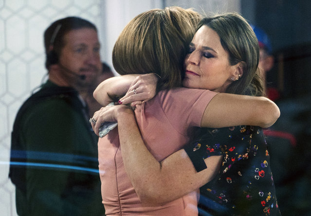 """Co-anchors Hoda Kotb, left, and Savannah Guthrie embrace on the set of the """"Today"""" show Wednesday, November 29, 2017, in New York, after NBC News fired host Matt Lauer. NBC News announced Wednesday that Lauer was fired for """"inappropriate sexual behavior"""". (Photo by Craig Ruttle/AP Photo)"""