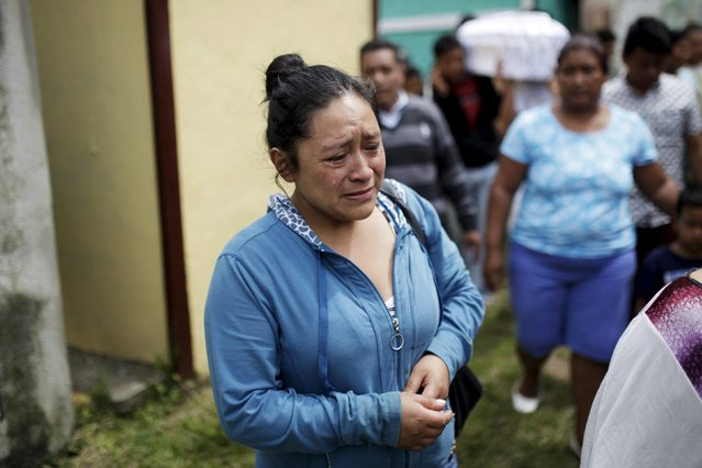 Relatives participate in a funeral of two victims of a  mudslide in Santa Catarina Pinula, on the outskirts of Guatemala City, October 3, 2015. (Photo by Jose Cabezas/Reuters)