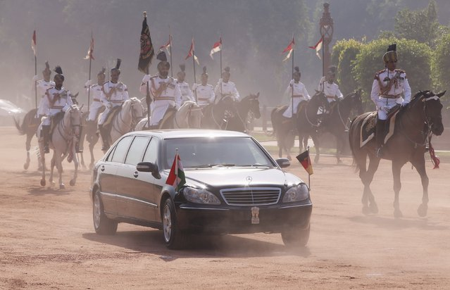 German Chancellor Angela Merkel arrives in her car to attend her ceremonial reception at the forecourt of India's Rashtrapati Bhavan presidential palace in New Delhi, India, October 5, 2015. Merkel is on a three-day state visit to India. (Photo by Adnan Abidi/Reuters)