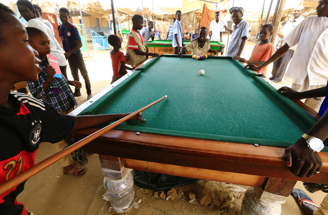 Children play billiard in Abu Shock IDPs camp in Al Fashir, capital of North Darfur, Sudan, September 6, 2016. (Photo by Mohamed Nureldin Abdallah/Reuters)