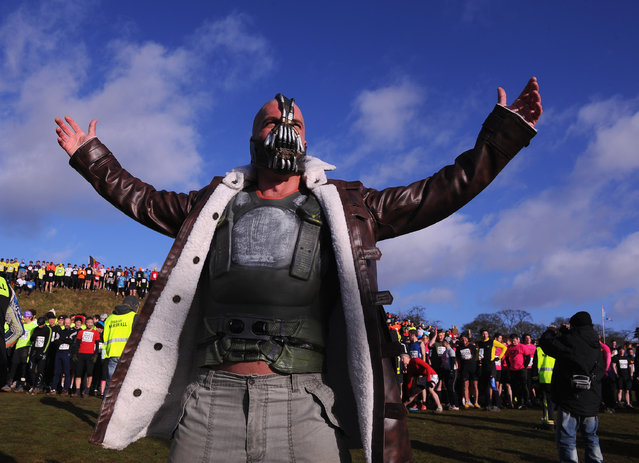 """A competitor dressed as """"Bain"""" from the Batman films poses before the Tough Guy Challenge endurance race on January 27, 2013 in Telford, England. Every year thousands of people run the 8 mile assault course which involves freezing temperatures, fire and ice.  (Photo by Michael Regan)"""