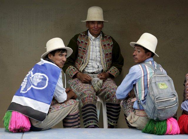 "Residents of Vila Vila are seen during the inauguration of a sports arena called ""Coliseo Ban Ki-Moon"" in Vila Vila, south of Cochabamba, October 11, 2015. (Photo by David Mercado/Reuters)"