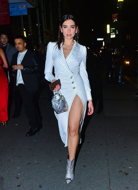 Dua Lipa looks striking in a white tuxedo dress as she heads to the Grammy after party in NYC on January 29, 2018. (Photo by Splash News and Pictures)