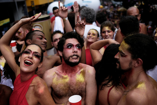 """Revellers take part in an annual block party known as """"Academicos do Baixa Augusta"""" (Academics of Baixa Augusta neighbourhood ), during carnival festivities in Sao Paulo, Brazil on February 4, 2018. (Photo by Nacho Doce/Reuters)"""