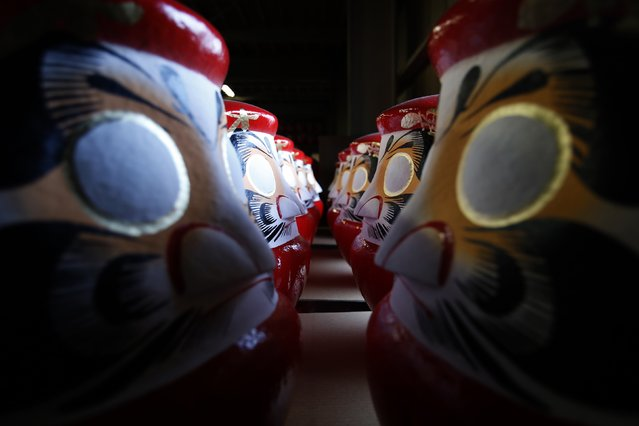 "Daruma dolls, which are believed to bring good luck, are stored at a studio of Daruma doll shop  ""Daimonya"" in Takasaki, northwest of Tokyo November 23, 2014. (Photo by Yuya Shino/Reuters)"