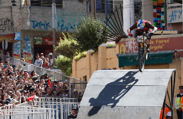 Tomas Slavik of Czech Republic in action after crossing the finish line and winning the race during the Valparaiso mountain bike downhill race in Valparaiso, Chile on February 11, 2018. (Photo by Rodrigo Garrido/Reuters)