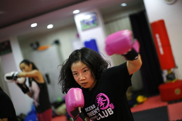 A woman attends a boxing class at Princess Women's Boxing Club in Shanghai December 3, 2014. (Photo by Carlos Barria/Reuters)
