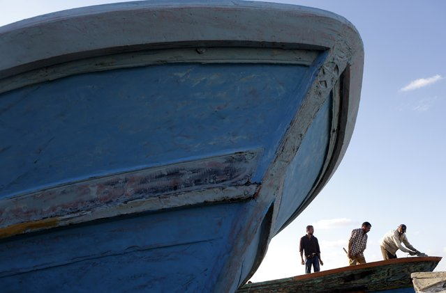 Fishermen repair boats at the entrance to the fishermen's village in the El Max area in the Mediterranean city of Alexandria September 12, 2014. (Photo by Amr Abdallah Dalsh/Reuters)