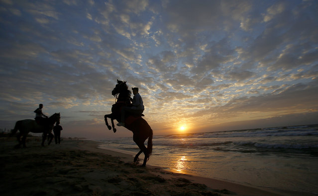 Palestinians rides horses on Gaza beach as the sun sets in Gaza City, Wednesday, November 4, 2020. (Photo by Hatem Moussa/AP Photo)