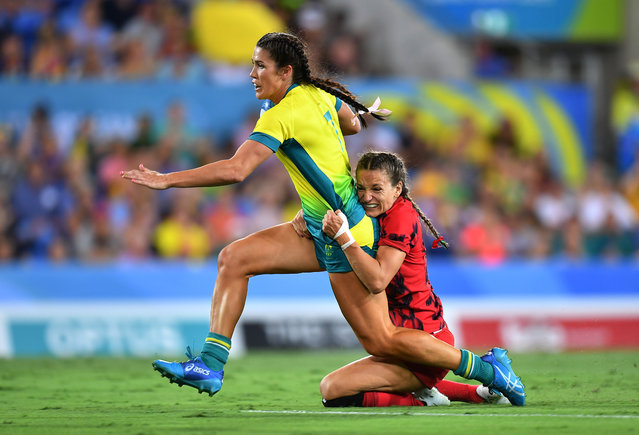 Charlotte Caslick of Australia is tackled by Jasmine Joyce of Wales during the Rugby Sevens Women's Pool B match between Australia and Wales on day nine of the Gold Coast 2018 Commonwealth Games at Robina Stadium on April 13, 2018 on the Gold Coast, Australia. (Photo by Dan Mullan/Getty Images)