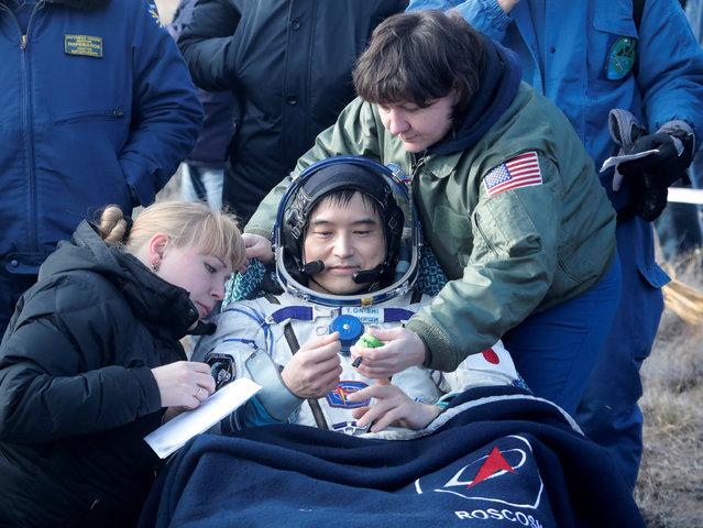 Specialists help International Space Station (ISS) crew member Takuya Onishi of Japan shortly after the landing of the Russian Soyuz MS space capsule near the town of Dzhezkazgan (Zhezkazgan), Kazakhstan, October 30, 2016. (Photo by Dmitri Lovetsky/Reuters)