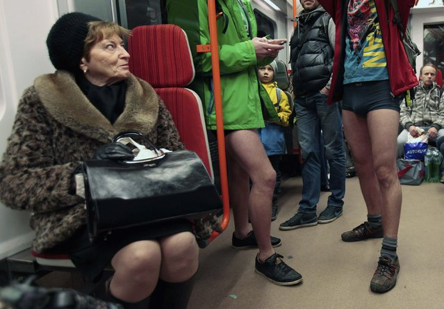 """Passengers (R) not wearing pants stand in a subway train during the """"No Pants Subway Ride"""" in Prague January 11, 2015. (Photo by David W. Cerny/Reuters)"""