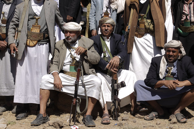 Tribesmen loyal to the Shi'ite Houthi group attend a tribal gathering to show support to the group in Amran province north of the Yemeni capital Sanaa March 13, 2014. (Photo by Khaled Abdullah/Reuters)