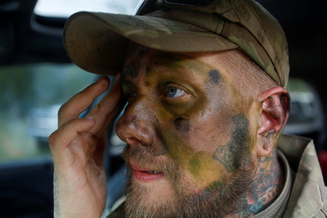 Jason Van Tatenhove, a member of the Oath Keepers, puts on camouflage face paint during a tactical training session in western Montana, U.S. April 30, 2016. (Photo by Jim Urquhart/Reuters)