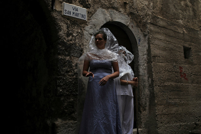Women wear costumes as part of an art installation in the mostly abandoned old centre of the town of Catsel Vecchio in the province of L'Aquila in Abruzzo, inside the national park of the Gran Sasso e Monti della Laga, Italy, September 11, 2016. (Photo by Siegfried Modola/Reuters)