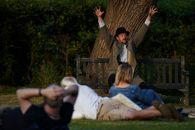 """Actor Chris Hannon from the Park Bench Theatre performs Samuel Beckett's """"First Love"""" during an open air play in a socially distanced covid secure space in Rowntree Park on August 12, 2020 in York, England. As coronavirus lockdown restrictions are eased in many areas, the theatre and the arts sectors begin to re-start their businesses. """"First Love"""" is a short story by Samuel Beckett, written in 1946 and first published in its original French version in 1970 and, in Beckett's English translation, in 1973. The Park Bench Theatre season is being presented by Engine House Theatre. (Photo by Ian Forsyth/Getty Images)"""