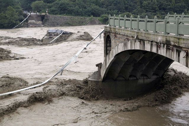 A bridge is collapsed after being hit by sweeping floods in Jiangyou, Sichuan province, July 9, 2013. (Photo by Reuters/Stringer)