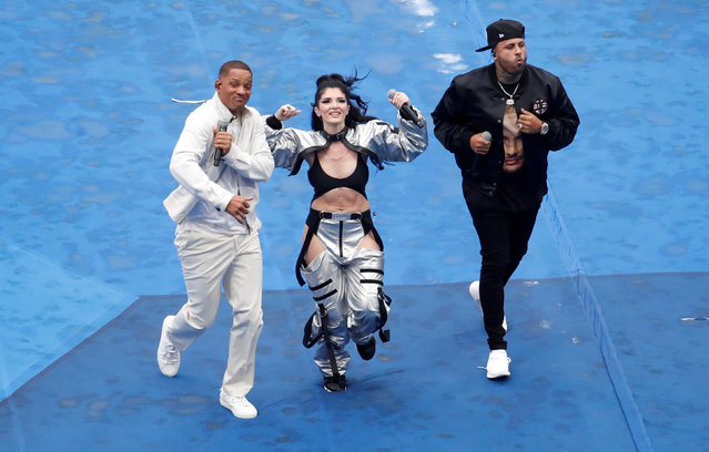 US singer Will Smith (L), Kosovo' s singer Era Istrefi (C) and US rapper Nick Rivera Caminero aka Nicky Jam (R) perform during the closing ceremony prior to the Russia 2018 World Cup final football match between France and Croatia at the Luzhniki Stadium in Moscow on July 15, 2018. (Photo by Christian Hartmann/Reuters)