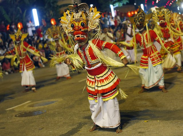 Traditional dancers perform at Navam Perahera, a Buddhist pageant of elephants, dancers and drummers, in Colombo February 3, 2015. (Photo by Dinuka Liyanawatte/Reuters)
