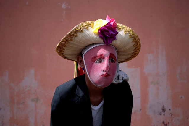 A man with a mask poses for a portrait as he takes part in festivities in honour of patron saint San Jeronimo in Masaya city, Nicaragua November 20, 2016. (Photo by Oswaldo Rivas/Reuters)
