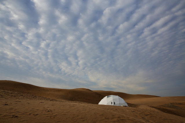 A toilet is seen in Xiangshawan Desert, also called Sounding Sand Desert on July 17, 2013 in Ordos of Inner Mongolia Autonomous Region, China. Xiangshawan is China's famous tourist resort in the desert. It is located along the middle section of Kubuqi Desert on the south tip of Dalate League under Ordos City. Sliding down from the 110-metre-high, 45-degree sand hill, running a course of 200 metres, the sands produce the sound of automobile engines, a natural phenomenon that nobody can explain.  (Photo by Feng Li/Getty Images)