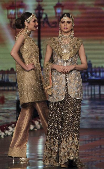 Models present creation of designer Umsha by Uzama Babar during Bridal Couture Week 2016 in Lahore, Pakistan, Sunday, November 27, 2016. (Photo by K.M. Chaudary/AP Photo)