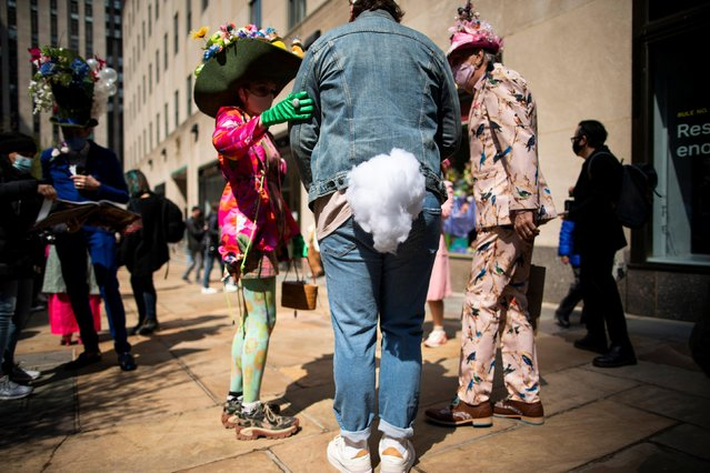 People attend the annual Easter Parade and Bonnet Festival on Fifth Avenue, amid the coronavirus disease (COVID-19) pandemic, in New York City, U.S., April 4, 2021. (Photo by Eduardo Munoz/Reuters)