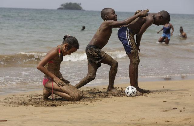 Children play at Arena Blanca beach in Malabo, Equatorial Guinea, Saturday January 31, 2015. (Photo by Sunday Alamba/AP Photo)