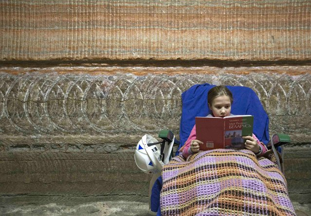 A girl reads a book while resting in the facilities of Belarus' Republican Clinic of Speleotherapy within a salt mine near the town of Soligorsk, south of Minsk, February 19, 2015. (Photo by Vasily Fedosenko/Reuters)