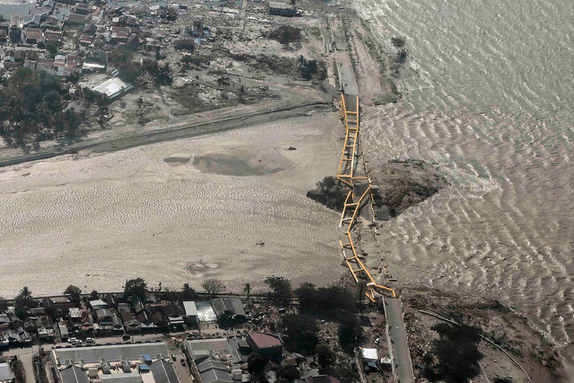 An aerial view shows bridge damaged by an earthquake and tsunami in Palu, Central Sulawesi, Indonesia September 29, 2018. (Photo by Muhammad Adimaja/Reuters/Antara Foto)