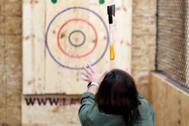 Teri Watson participates in axe throwing, a sport that started in the Canadian backwoods and is growing in popularity in U.S. cities, at LA Ax in North Hollywood, Los Angeles on October 10, 2018. (Photo by Lucy Nicholson/Reuters)