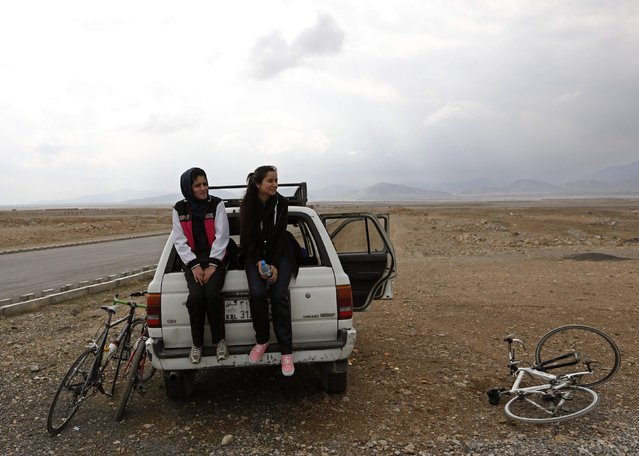 Members of Afghanistan's Women's National Cycling Team sit on the back of a car after a training exercise on the outskirts of Kabul February 20, 2015. (Photo by Mohammad Ismail/Reuters)