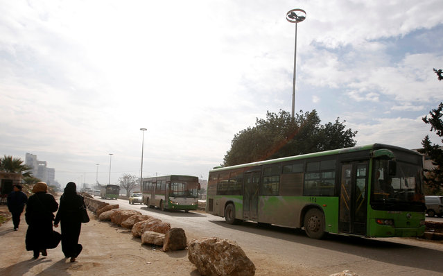 Empty buses are seen leaving after the evacuation of people from eastern Aleppo was suspended, Syria December 16, 2016. (Photo by Omar Sanadiki/Reuters)