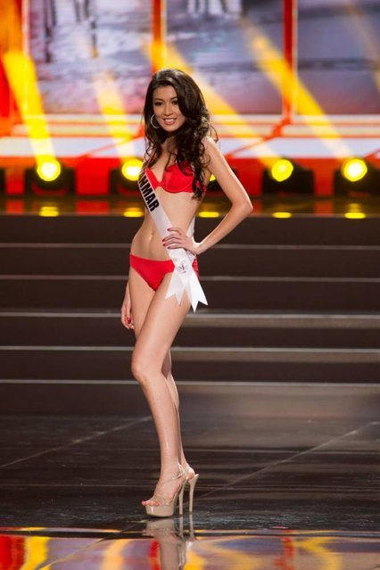 This photo provided by the Miss Universe Organization shows Moe Set Wine, Miss Myanmar 2013, competes in the swimsuit competition during the Preliminary Competition at Crocus City Hall, Moscow, on November 5, 2013. (Photo by Darren Decker/AFP Photo)